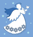 Angel with dove of peace patterned gown and wings releasing Royalty Free Stock Photos