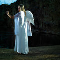 Angel on earth angels lady posing with wings outdoor in nature by the lake Stock Photos