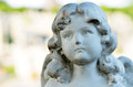 Angel face cute statue with weathered baby Stock Photo