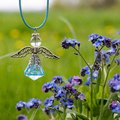 Angel figure and blue flowers Royalty Free Stock Photo