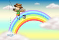 An angel fishing above the rainbow Royalty Free Stock Photo