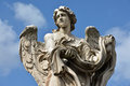 Angel with Garment and Dice from Ponte Sant'Angelo, in Rome Royalty Free Stock Photo