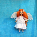 Angel girl doll in heaven on blue canvas background Royalty Free Stock Image