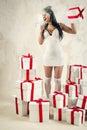 Angel girl shouting through megaphone Royalty Free Stock Photo
