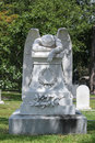Angel of grief gravestone in peaceful cemetery Stock Images