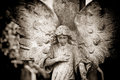 Angel with hand on heart in sepia Stock Photo