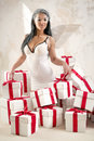 Angel with heap of gift boxes Royalty Free Stock Photo