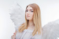 An angel from heaven. Young, wonderful blonde girl in the image of an angel with white wings. Royalty Free Stock Photo