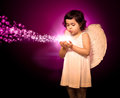 Angel little girl with magical lights in hands Royalty Free Stock Photography