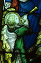Angel making music with a trumpet (stained glass) Royalty Free Stock Photo