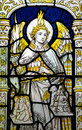 Angel michael weighing the souls in stained glass a photo of Royalty Free Stock Photo