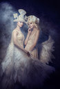 Picture : Angel nymph fairy art pictures of women. Girls with angel wings, beauty models posing on a dark background. Fairy tale magic magic background little home