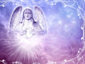 Angel a statue of over mystical background with rays of light Royalty Free Stock Photo