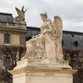 Angel statue at Triumphal Arch Arc de Triomphe du Carrousel at Tuileries. The monument was built between 1806 - 1808 to Royalty Free Stock Photo