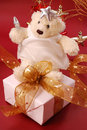 Angel teddy bear sitting on gift box Royalty Free Stock Image