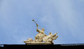 Angel the trumpeter a sculpture on a building roof. Lviv, Ukraine. Royalty Free Stock Photo