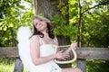Angel woman with harp II Royalty Free Stock Photo