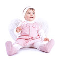 Angelic baby sitting in the studio isolated on white background cute little girl wearing pink dress and feather wings purity and Stock Photography