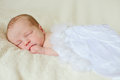 Angelic newborn sleeping with feather wings Royalty Free Stock Photos