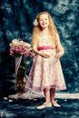 Angelic retro portrait of a beautiful little girl smiling at camera vintage background Stock Image
