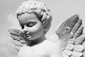 Angelic statue isolated on sky Stock Photos