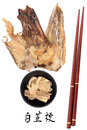 Angelica herb root used in traditional chinese herbal medicine with mandarin title script translation and chopsticks dang gui Royalty Free Stock Photography
