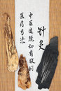 Angelica root acupuncture needles with herb and mandarin script on rice paper over bamboo dang gui pian translation describes Royalty Free Stock Images