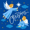 Angels and Christmas Star in the Night Sky Royalty Free Stock Photo