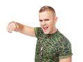 Anger furious army soldier pointing towards camera