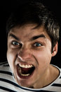 Anger the guy s face expresses Royalty Free Stock Images