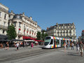 Angers france july tramway in the town center square rainbow colored Stock Image