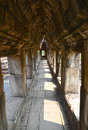 Angkor temple hallway a lined with beautifully repeating columns located adjacent to Stock Photo