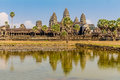 Angkor Wat across the lake, reflected in water Royalty Free Stock Photo