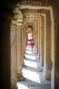 Angkor wat a girl standing among the pillars at the temple of siem reap cambodia Stock Photo