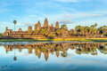 Angkor wat status of in sunset the golden shine the best time in the evening at siem reap cambodia Royalty Free Stock Photography