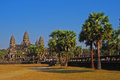 Angkor wat temple on a sunny day with sugar palm Stock Photo