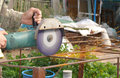 Angle grinder metal sawing with flashing sparks close up and repairman hands home repair garden working summer time also called Royalty Free Stock Images