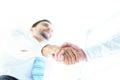 Angle-shot of shake hands Royalty Free Stock Photo