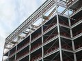 Angled view of a large building development under construction with steel framework and girders supporting the metal floors with b Royalty Free Stock Photo