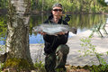 Angler with fly fishing trophy happy big trout like a wishing Royalty Free Stock Image