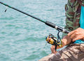 Angler man fishing is at gulf of thailand Royalty Free Stock Photos