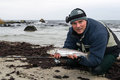 Angler with winter sea trout portrait of on the beach Stock Images