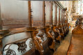 Anglican church interior row of ancient wooden chairs in an Royalty Free Stock Photos