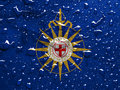 Anglican communion flag of with rain drops Royalty Free Stock Photo