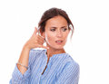 Angry adult lady wondering with call gesture Royalty Free Stock Photo