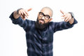 Angry aggressive african man pointing to camera with both hands american baldheaded beard in glasses Royalty Free Stock Image