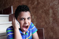 Angry arab muslim child talking in mobile phone Royalty Free Stock Photo