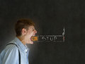 Angry big mouth businessman teacher student man trying to stop smoking chalk cigarette blackboard background Royalty Free Stock Photo