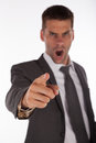 Angry boss pointing finger yelling and focus on the hand Stock Photography