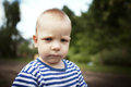 Angry boy portrait little close up photo Royalty Free Stock Photography